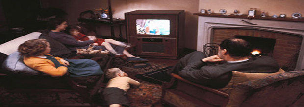 Family watching TV in 1968